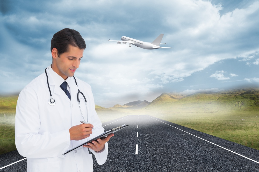 Composite image of smiling doctor holding pen and clipboard.jpeg