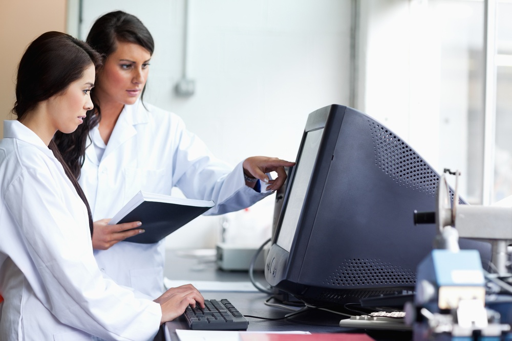 Female scientists looking at a monitor in a laboratory.jpeg