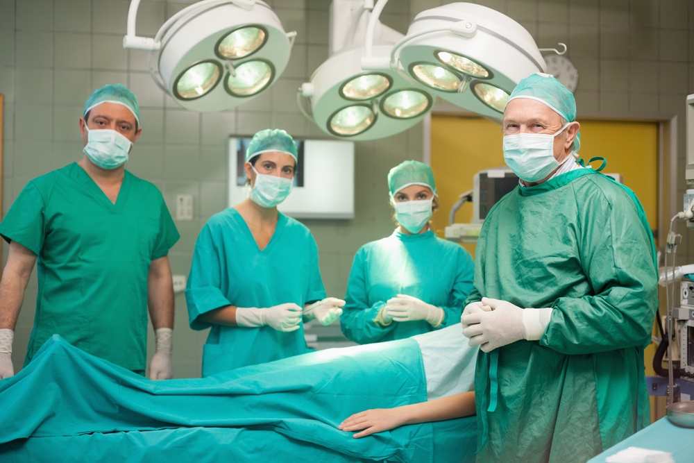 Medical team surrounding a patient in a surgical room.jpeg